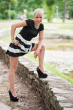 Attractive blonde posing near the lake Stock Photography