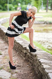 Attractive blonde posing near the lake Royalty Free Stock Photography