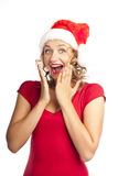 Attractive blonde in a positive Christmas hat Royalty Free Stock Image