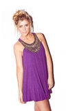 Attractive blonde in purple dress Royalty Free Stock Photos