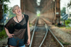 Attractive blonde on the railroad Royalty Free Stock Photos