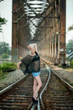 Attractive blonde on the railroad Royalty Free Stock Image