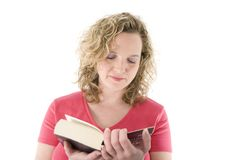 Attractive blonde reading. A book isolated on white Stock Images