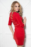 Attractive blonde in red dress Stock Photos