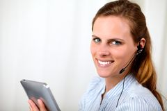 Attractive blonde secretary smiling on callcenter royalty free stock photography