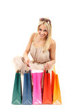 Attractive blonde with shopping bags Stock Images