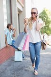 Attractive blonde on a shopping trip Royalty Free Stock Photo