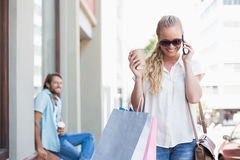 Attractive blonde on a shopping trip Royalty Free Stock Image