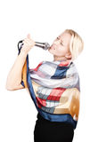 Attractive blonde singing with passion Stock Photography