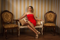 Attractive blonde sitting on the couch Royalty Free Stock Photo