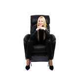 Attractive blonde sitting on couch. Smiling attractive blonde sitting on the couch with her hands under her chin. White background Stock Images