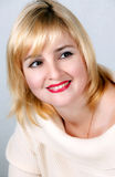 Attractive blonde smiling woman portrait Stock Photos
