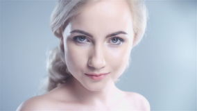 Attractive blonde smiling woman portrait on white background. stock video footage
