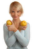 Attractive blonde with two lemons Stock Photography