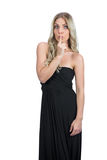 Attractive blonde wearing black dress hiding secret Royalty Free Stock Photos