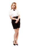 Attractive blonde wearing black mini skirt Stock Photo