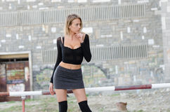 Attractive blonde wearing sexy mini skirt Stock Image