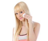 Attractive blonde woman applying make up Stock Photo