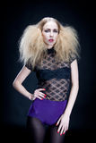 Attractive blonde woman with big hair and modern styling Royalty Free Stock Photo