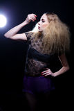 Attractive blonde woman with big hair and modern styling Stock Images