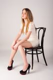 Attractive blonde woman on chair Royalty Free Stock Image