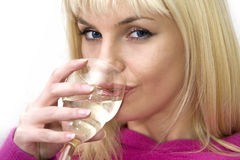 Attractive blonde woman drinking the wine Royalty Free Stock Photography