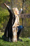 Attractive blonde woman enjoying the autumn sun Stock Images