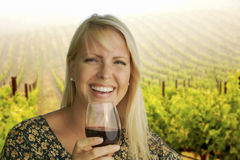 Attractive Blonde Woman Enjoying a Glass of Wine at the Vineyard Stock Photography