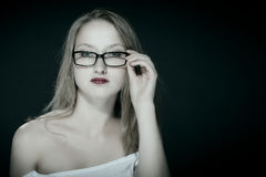 Attractive blonde woman with glasses Royalty Free Stock Image