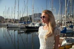 Attractive blonde woman in harbor. Stock Photo