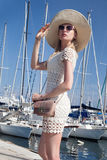 Attractive blonde woman in harbor. Royalty Free Stock Images