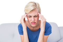 Attractive blonde woman having headache Royalty Free Stock Images
