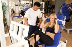 Attractive blonde woman and her trainer in a gym Royalty Free Stock Photography