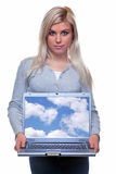 Attractive blonde woman holding a laptop Royalty Free Stock Images