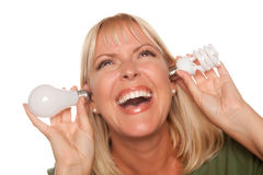 Attractive Blonde Woman Holds Energy Saving Light Stock Image