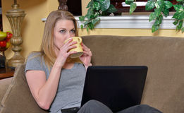 Attractive blonde woman with laptop and coffee Royalty Free Stock Photo