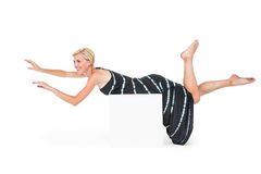 Attractive blonde woman lying on white block Stock Photography