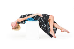 Attractive blonde woman lying on white block Royalty Free Stock Photography