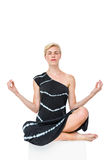Attractive blonde woman meditating Royalty Free Stock Photos