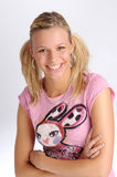 Attractive blonde woman in pink T-shirt Stock Photos