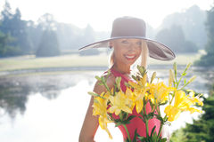 Attractive blonde woman posing outdoor stock images