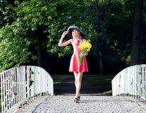 Attractive blonde woman posing outdoor Stock Image