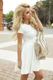 Attractive blonde woman posing. Attractive blonde smiling woman posing outdoor in sunny day stock photo