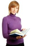 Attractive blonde woman reading a book. Isolated over white Royalty Free Stock Photography
