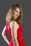 An attractive blonde woman in a red dress Royalty Free Stock Photos