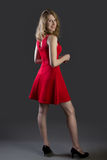 An attractive blonde woman in a red dress Stock Photography
