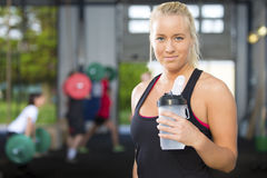 Attractive blonde woman rests at fitness gym Stock Photos
