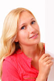 Attractive blonde woman with a sheet of paper Royalty Free Stock Image