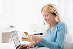 Attractive blonde woman shopping online Royalty Free Stock Images
