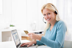 Attractive blonde woman shopping online Royalty Free Stock Photography